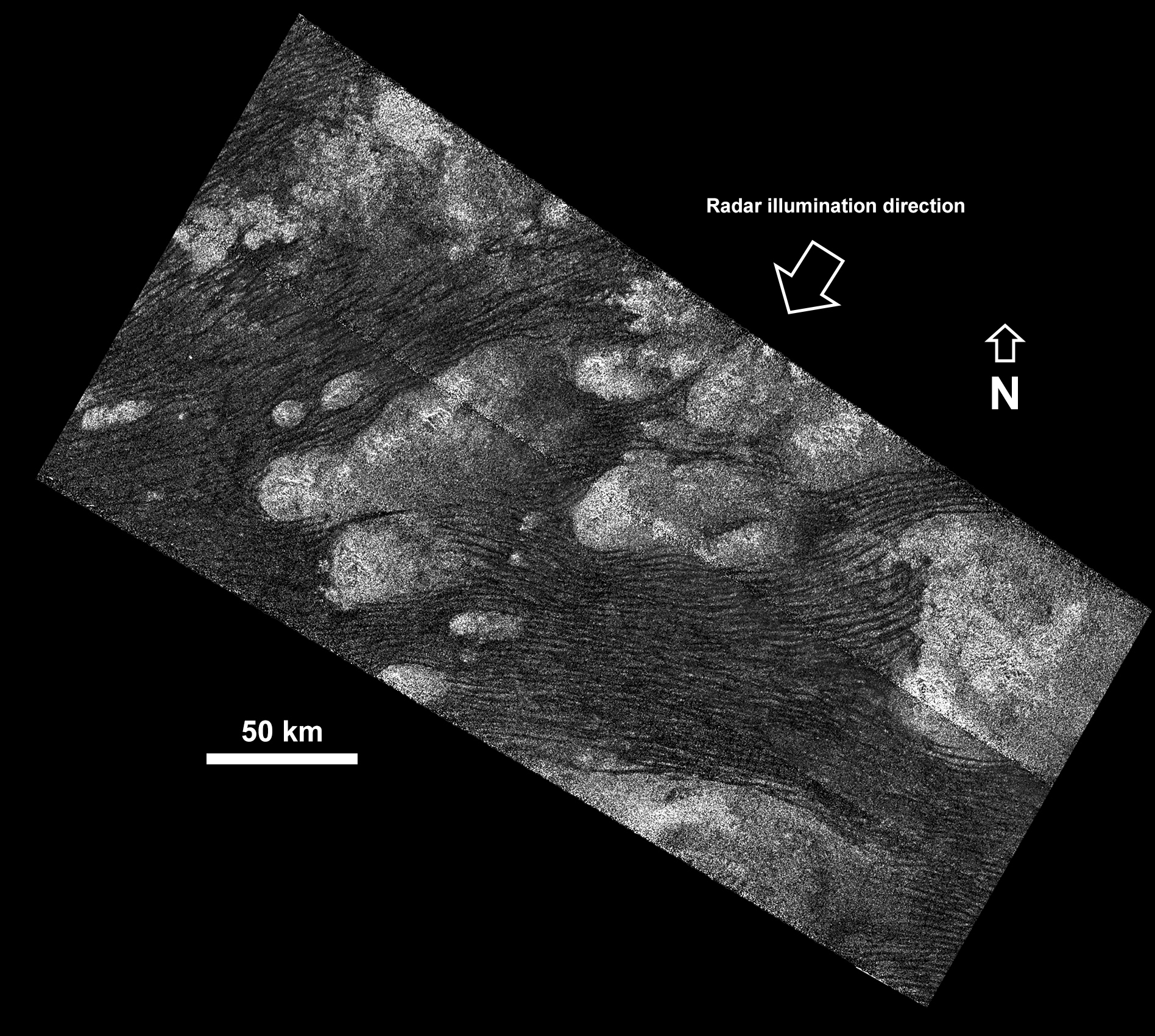 1567215422041-Cassini_SAR_Titan_Shangri-La_Sand_Sea_PIA20710_labeled.jpg