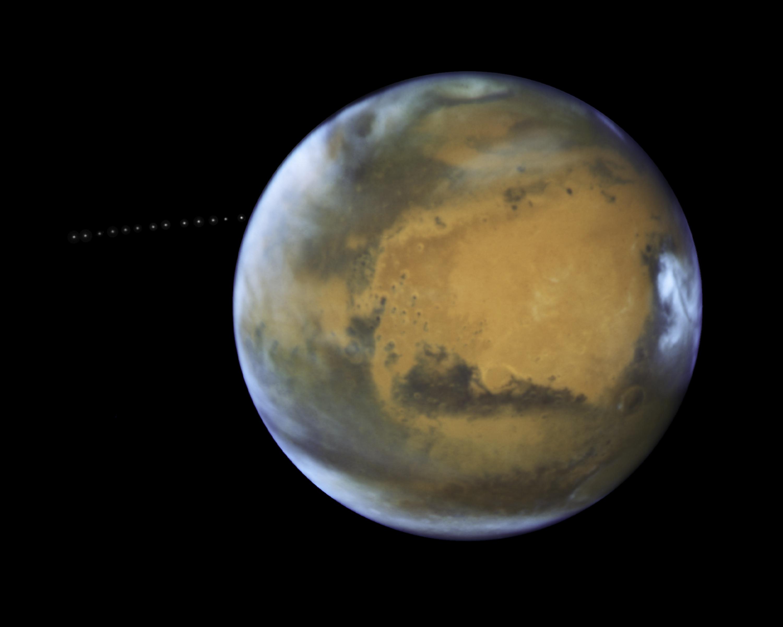 1567214330336-Phobos_orbiting_Mars.jpg