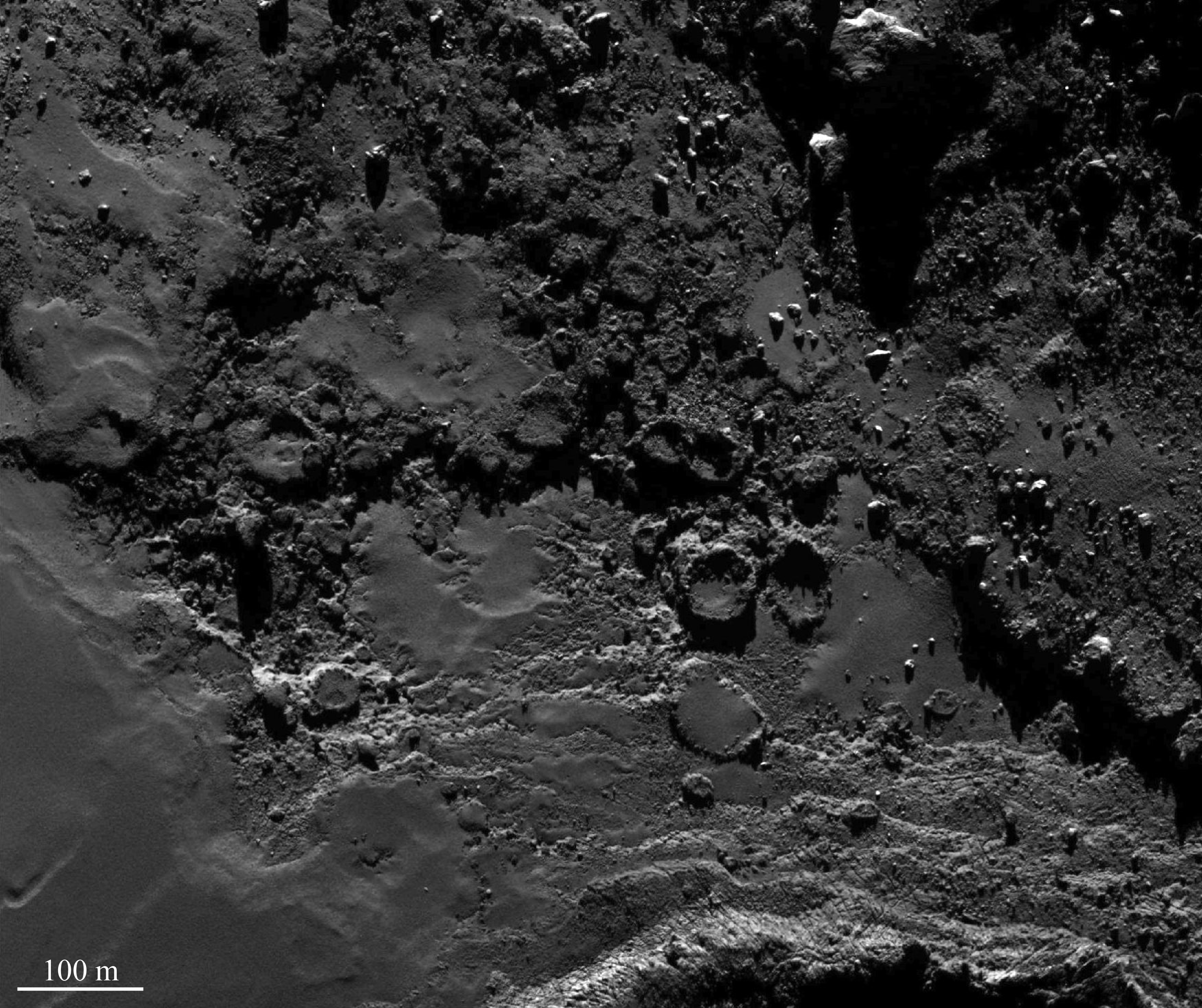 1567215879900-Rosetta_OSIRIS_NAC_67P_Round_features_in_Imhotep_a.png